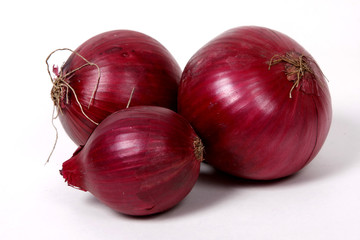 Red onions on the white background.