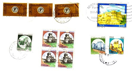 old (lire) and new (euro) italian post stamps..