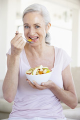 Senior Woman Eating Fresh Fruit Salad
