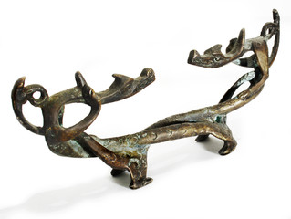 old figurine made of bronze in the form of two dragons