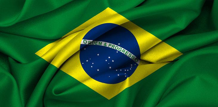 Brazilian flag waving on satin texture