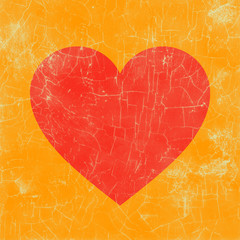 Weathered picture of a red heart with orange backdrop