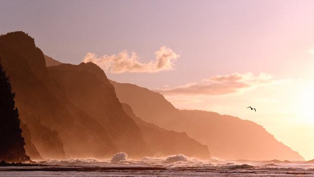 Sunset off the Na Pali coastline on Kauai with a stormy sea
