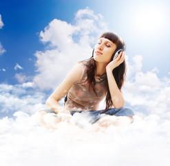 beautiful teenage listening music on the clouds