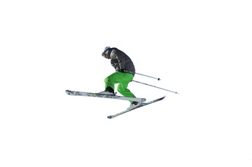 skier in bright green trousers jumping in the air