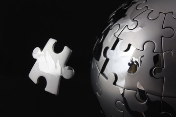 Floating jigsaw peiceover chrome puzzle globe
