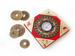 Feng shui compass and chinese coins.