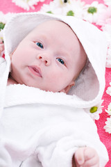 Cute baby with towel on head