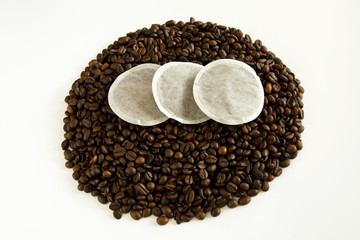 Coffee pads ontop of coffee beans