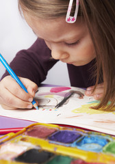 child concentrated on drawing a picture