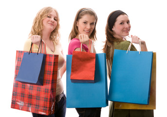 Three beautiful girls with shopping bags. Isolated on white