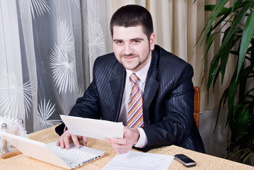 young emotional businessman working in restaurant