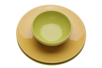 Yellow plate with green cup on white background