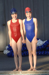 Twins Stand Beside Pool