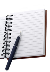 Open spiral lined notebook with pen