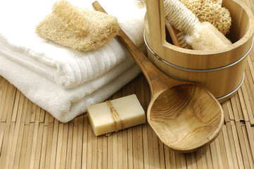 Fotobehang Spa bath accessories on the bamboo mat
