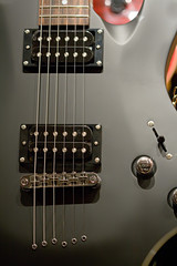 Black electric guitar with strings close-up