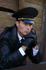 Military style man in peak-cap
