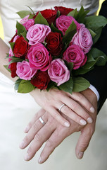 Wedding rings and bride bouqet