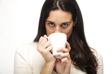 Portrait of a young woman drinking a hot beberage