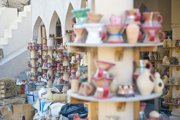 Traditional Eastern market with ceramic items.
