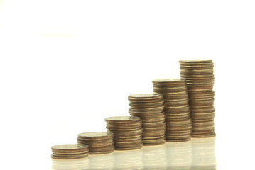Stacks coins on a white. Isolated. White backround