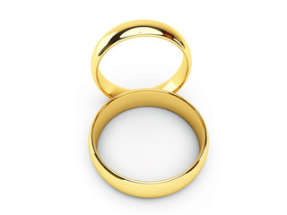 Wedding golden rings one over another. Isolated