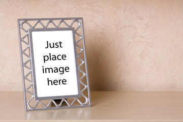 Photo frame on a wooden shelf