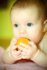 baby eates tangerine