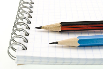 Spiral notepad with pencils