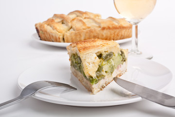 slice of spinach and green beans pie with a glass of wine