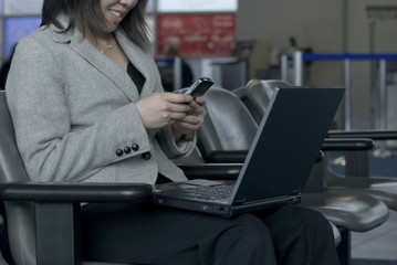 businesswoman working at airport gate