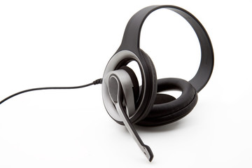 A black stereo headset isolated on a white background