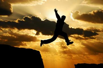 man jumping over a gap