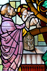 Colorful stain glass window of religious figures