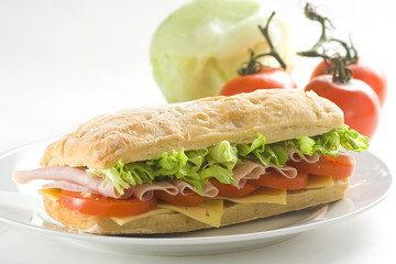 delicious sandwich of ham cheese lettuce tomato