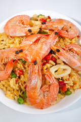 Spanish paella in a white bowl close-up