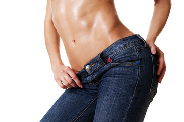 close-up of beautiful female body in jeans