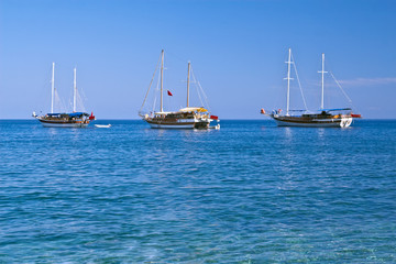 Three sailboats in sunny weather, with copyspace