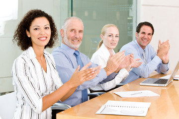 business people applauding at group meeting