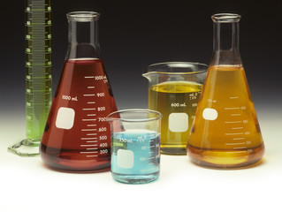 Scientific glassware filled with colored liquids
