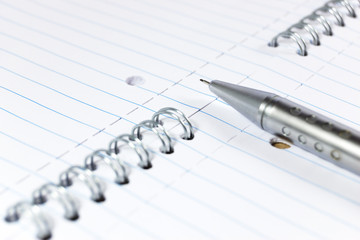 Mechanical pencil on a notepad