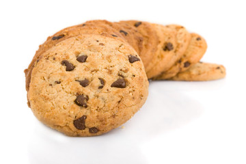 Pile of chocolate chip cookies isolated on white background.
