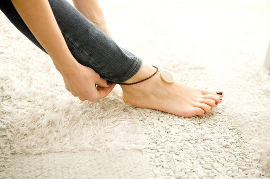 woman putting on sexy anklet