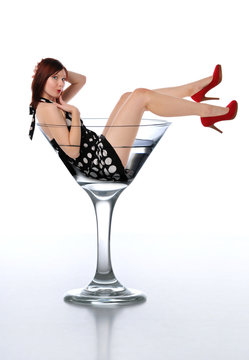 Young redheard woman in a martini glass