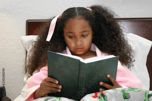 Adorable five year old african american girl reading in for 5 yr old beds