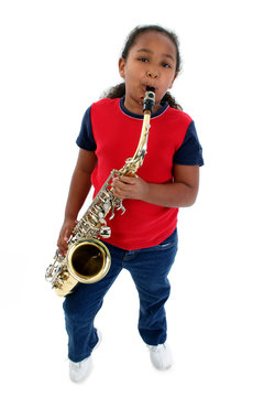 Girl playing saxophone.