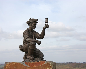 A Statue of a British Coal Miner.