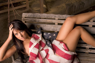 Young woman wrapped in American national flag