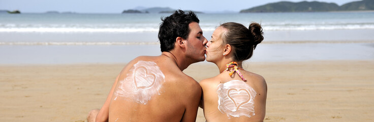Loving couple having fun on the beach